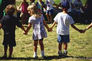 Children Holding Hands on School Playground