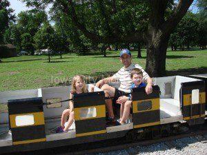 My husband and big kids riding the Hawkeye Express at City Park