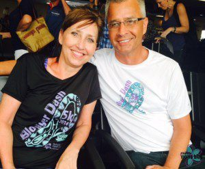 the best parents in the whole world, both wearing their Iowa City Moms Blog shirts in the airport!