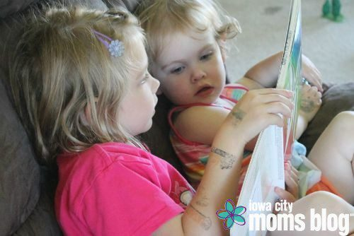 Raising little book lovers! This is my big girl (age 5) reading a story to my little girl (age 2).