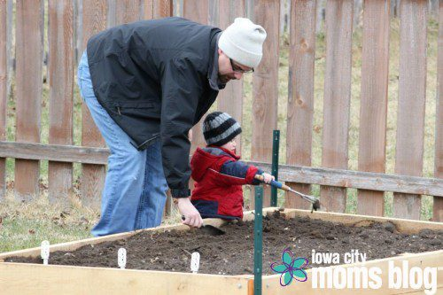 Prepping our raised bed garden for planting.