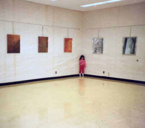 Me at the age of 6 at one of my mother's art openings.