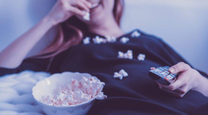 A woman binge watching a TV show