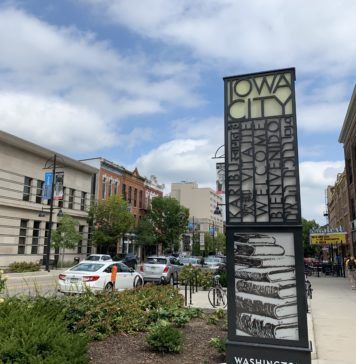 An image of the Iowa City sign on Washington Street in downtown Iowa City.
