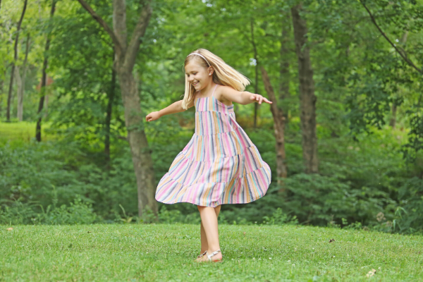 Photo of little girl twirling