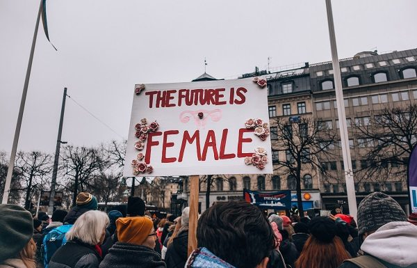 crowd of demonstrators holding signs for women's rights