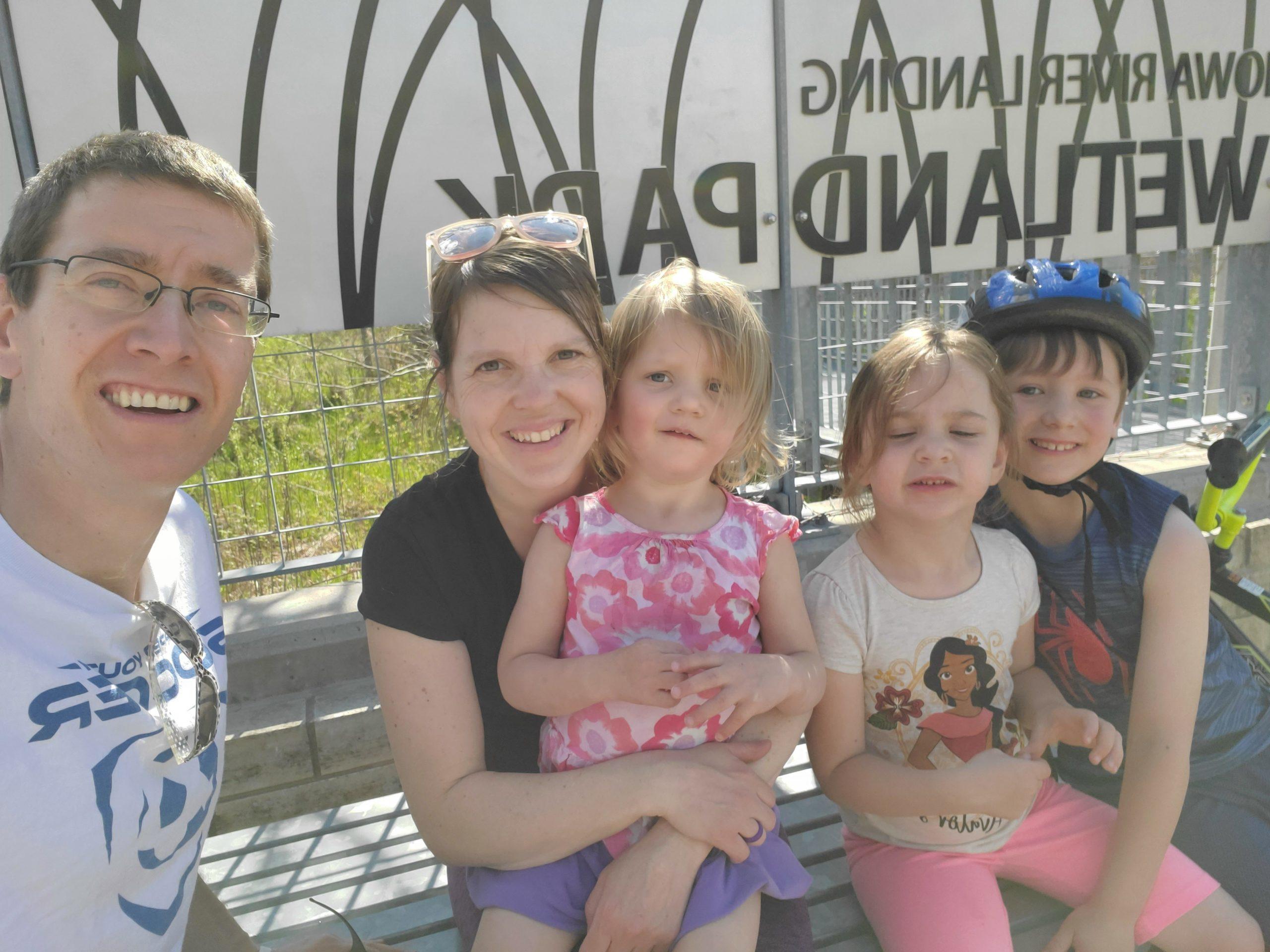A family enjoying a socially distant walk