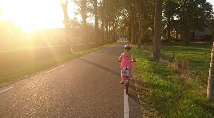 A child biking with a helmet on