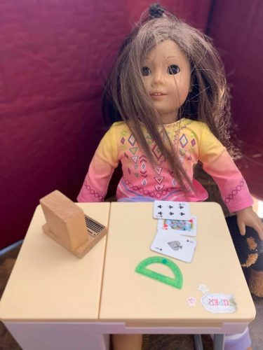 doll at desk with computer, cards