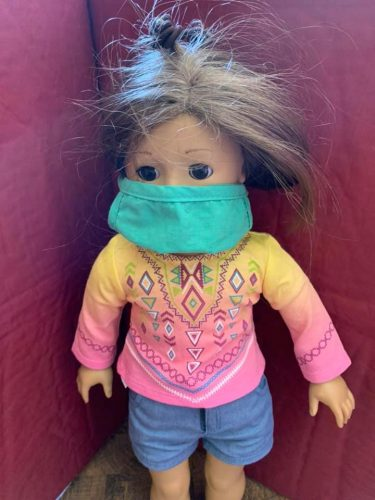 doll with green face mask