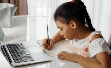 image of little girl in front of a laptop