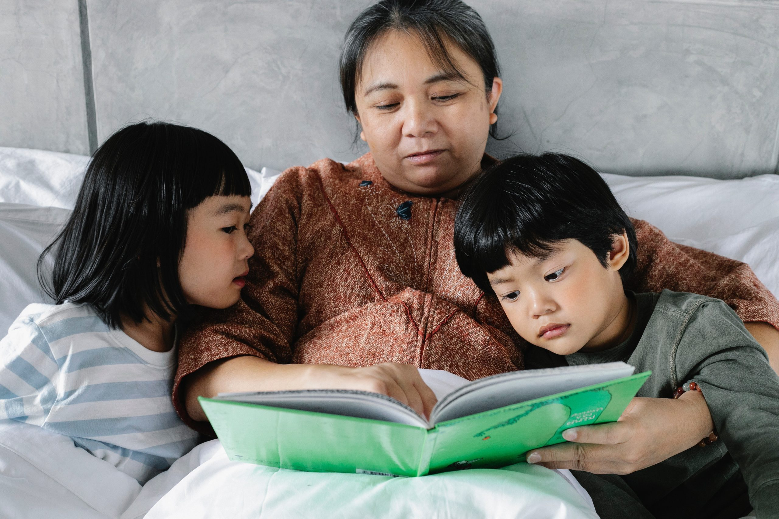 A woman reading to her kids