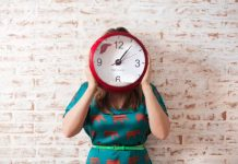 An image of a woman with a clock showing back to school morning routine